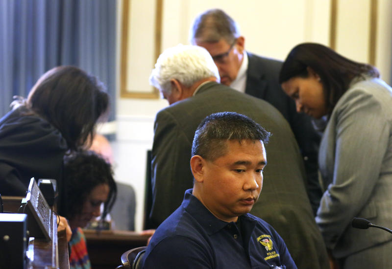 Judge Ghiz and attorneys holding a sidebar during testimony from Cincinnati police officer and crime scene investigator Jimmy Pham on June 12. Court records show they discussed which images of DuBose's body would be allowed during Pham's testimony.