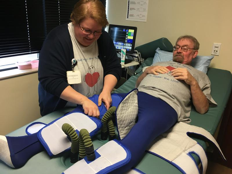 Mercy Anderson nurse Kay West tightens the cuffs of the EECP machine with patient Ron Schuler.