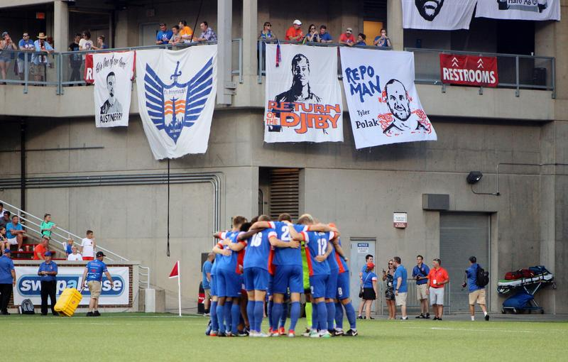FC Cincinnati's starting eleven huddle prior to kick-off against Valencia.