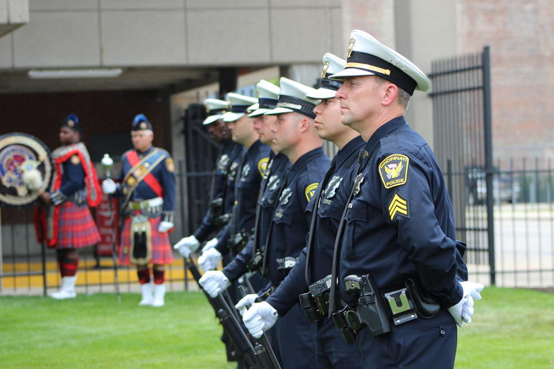 A Cincinnati police rifle line stands at attention during Police Memorial Week in 2015.
