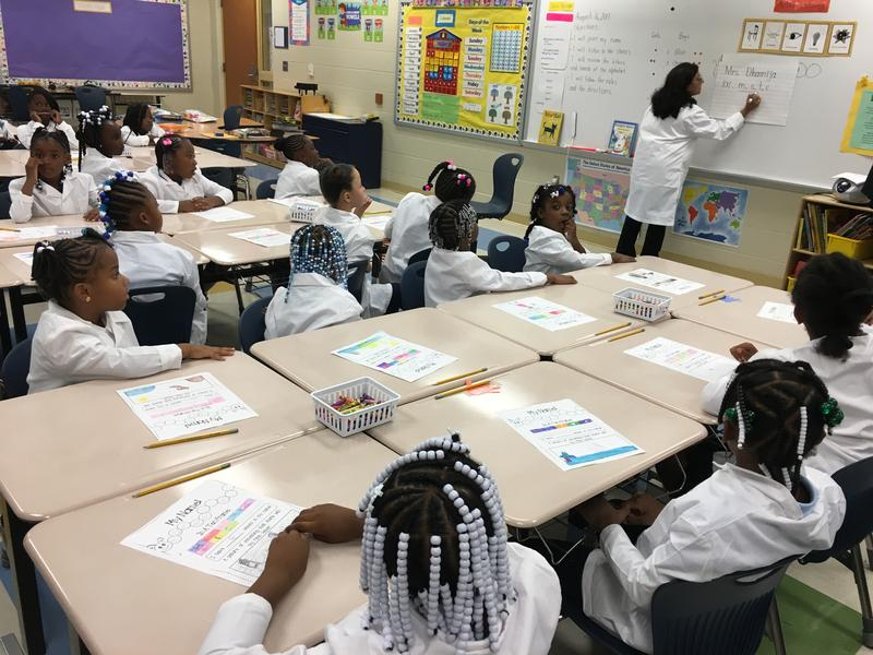 Bond Hill Academy has a new math and science focus and all kids wear lab coats.