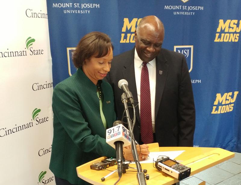 The presidents of Cincinnati State and Mount St. Joseph University sign the two-year, renewable agreement Tuesday morning.