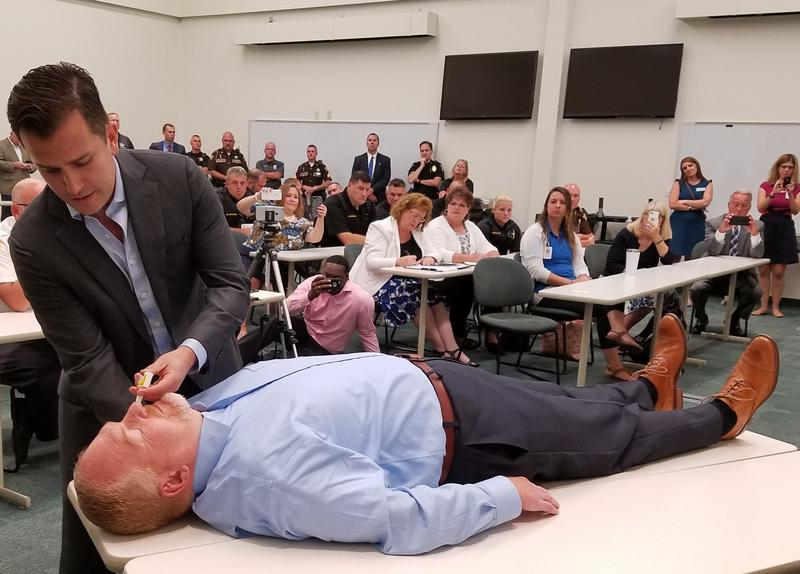 Aetna's Dan Knecht demonstrates how to administer Narcan, a nasal spray that reverses the effects of opioids.