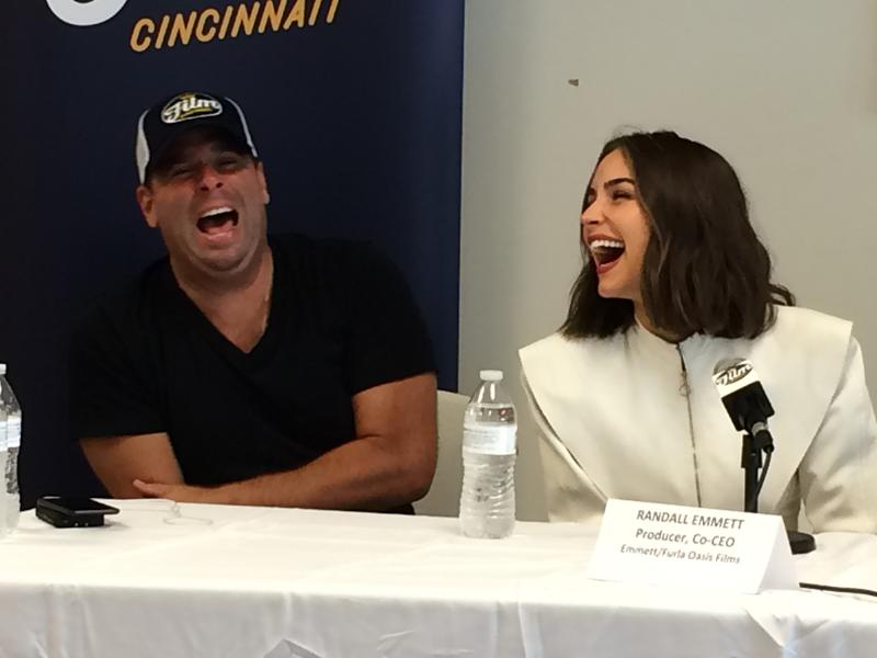 "Actress Olivia Culpo shares a laugh with ""Reprisal"" producer Randall Emmett."