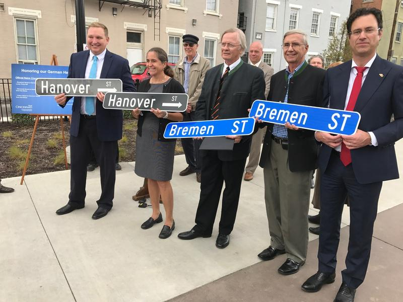 Representatives display new streets signs with original German names that will be returning to some Cincinnati streets.