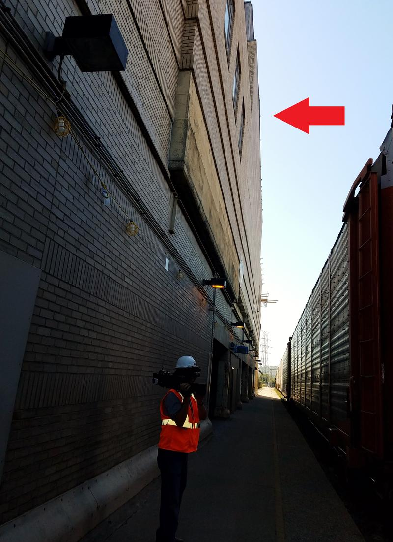 The red arrow in this October 2017 image indicates the back wall of the Omnimax Theater, which had to be replaced. It's about 40 feet tall, 100 feet wide, 20 feet off the ground, and 15 feet away from an active rail line.
