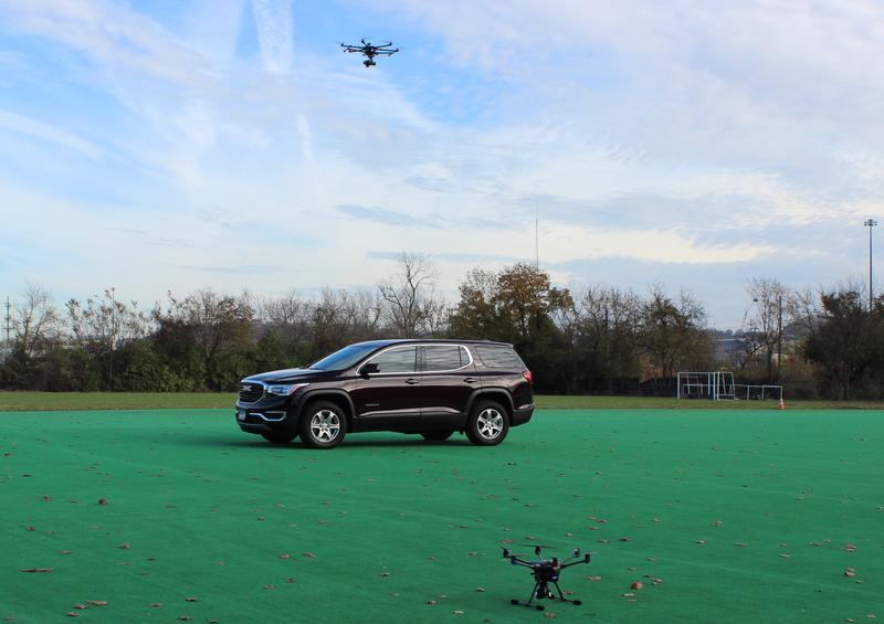 A police drone hovers over this vehicle collecting data and images like it would during a crash reconstruction. The department's second, smaller drone sits in the foreground.