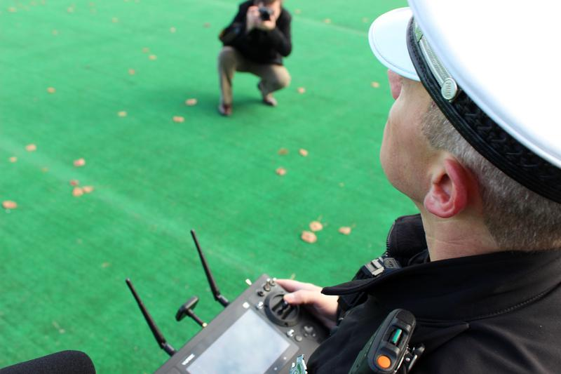 Specialist Rob Uhlenbrock pilots the drone during a demonstration at Spinney Field.