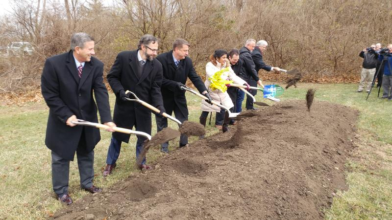 Dr. Lakshmi Sammarco and county leaders turn the dirt at the site of a planned crime laboratory.