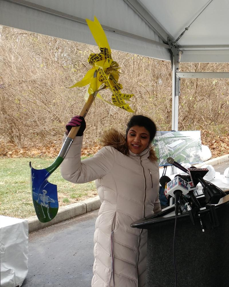Dr. Lakshmi Sammarco holds up the shovel reserved for her to use at the groundbreaking.