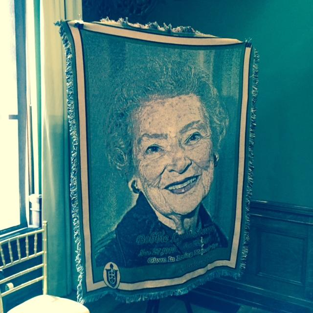 Tapestry depicting Bobbie Sterne during a service at Memorial Hall.