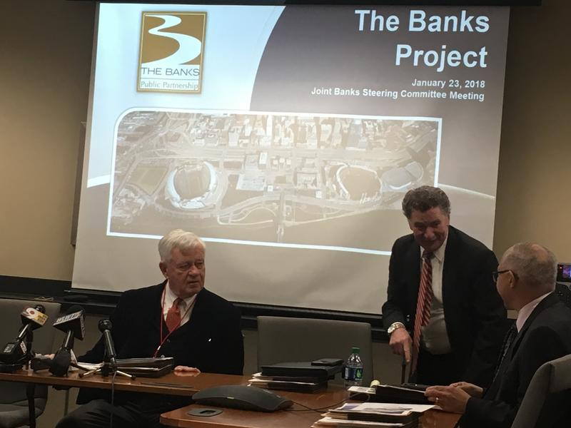 (from left) Robert Castellini, Tom Gableman and others discuss development at The Banks