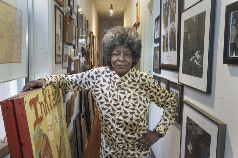 Writer Kathy Y. Wilson in her East Walnut Hills apartment where she has amassed an art collection.