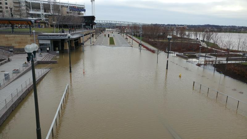 Flood waters covered Mehring Way and forced the closure of the bottom level of the Banks parking garage.