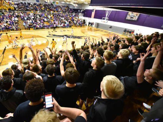 Elder student section celebrates a 3-pointer.