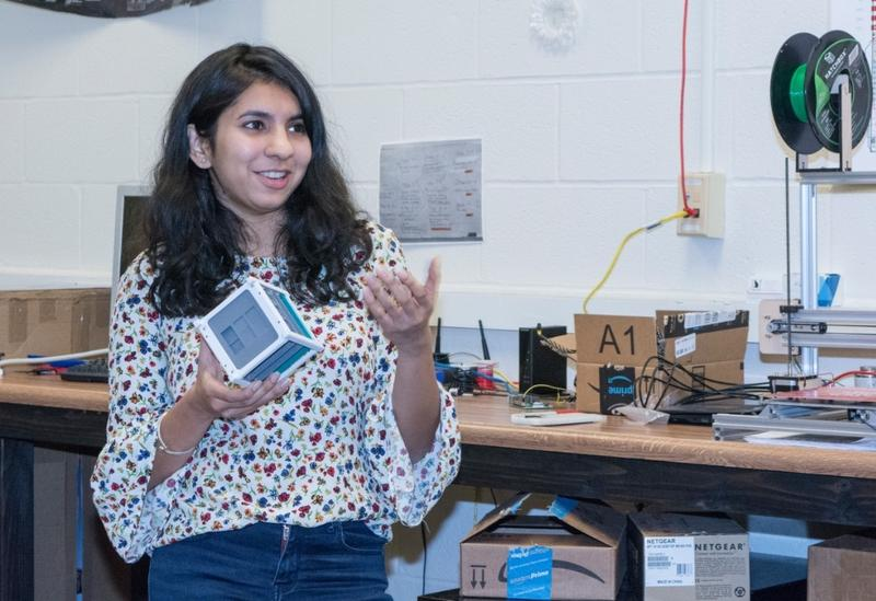 woman holding a cubesat
