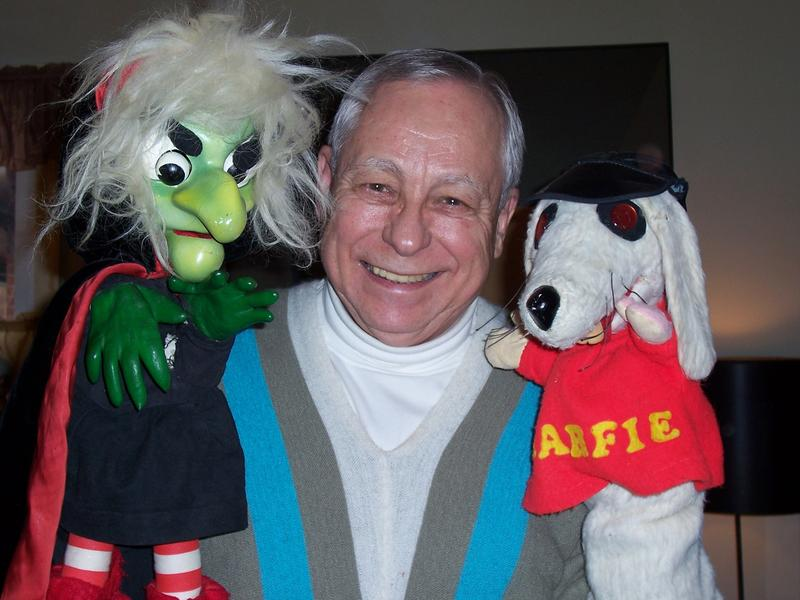 Larry Smith with Hattie the Witch and Snarfie R. Dog at his home in 2008.