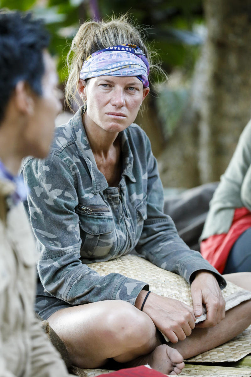 Angela Perkins talks to James Lim around the 'Survivor' campfire.