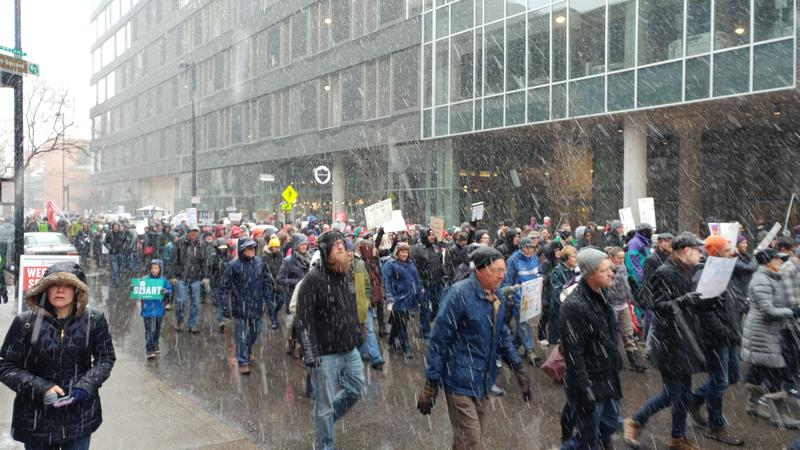 Marchers had to contend with a wet snow.