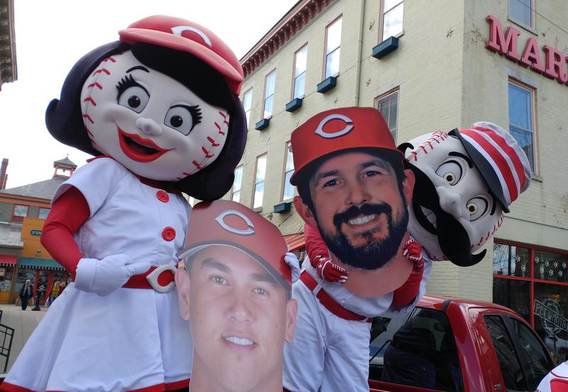 Rosie Red and Mr. Redlegs hold cutouts of Danny Graves (left) and Sam LeCure (right).