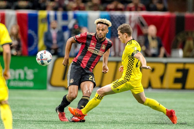 Atlanta and Columbus player battle for the soccer ball.