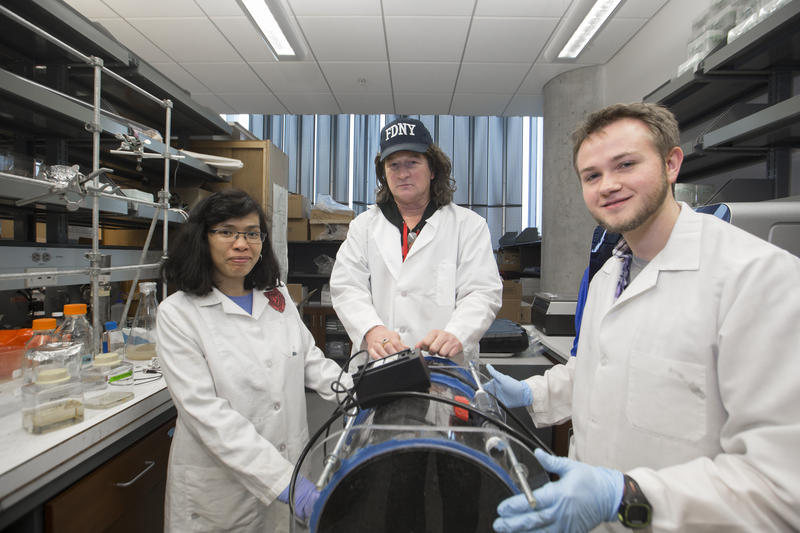 Daniel Hassett, PhD, (center) is shown with Warunya Panmanee, PhD, research associate, (left) and Cameron McDaniel, PhD student (right) in a laboratory in the UC College of Medicine.
