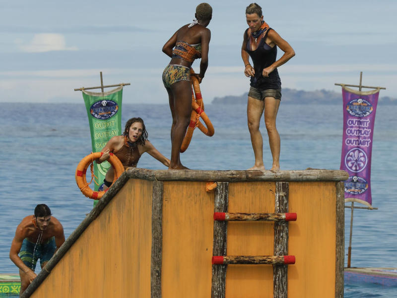 Angela Perkins (right)  stands atop a floating dock during the immunity challenge Wednesday.