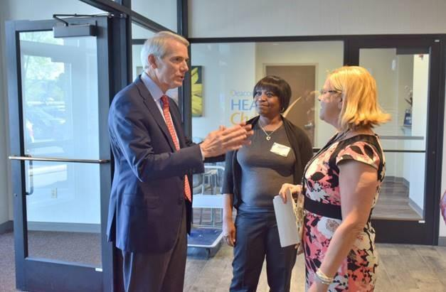 Sen. Rob Portman talks with attendees at a Friday morning breakfast at the Center for Addiction Treatment honoring local leaders.