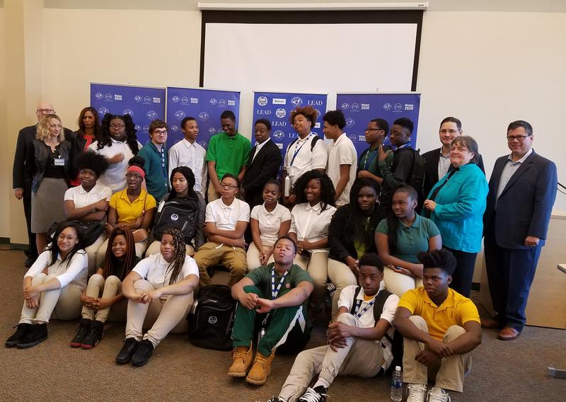 Students in Taft IT High School's new cybersecurity certificate program pose with school and business leaders.