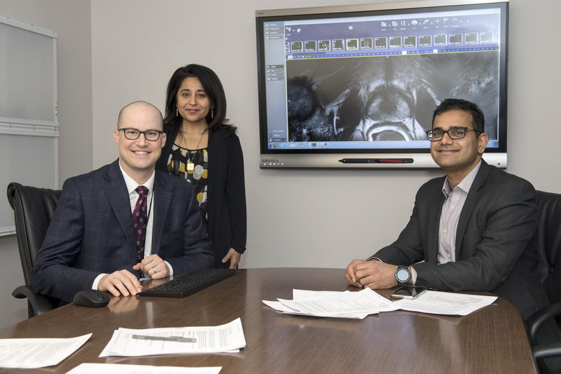 Abhinav Sidana, MD (right), Timothy Struve, MD (left), and Sadhna Verma, MD (top left), members of the UC Cancer Institute and UC Health physicians, created a multidisciplinary prostate cancer clinic for patients to learn about options for treatment.