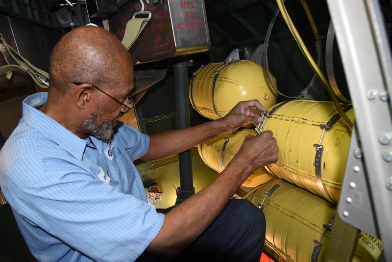 Museum restoration specialist Dave Robb installs oxygen tanks in the Boeing B-17F Memphis Belle.