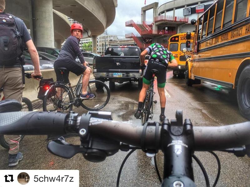 Cyclists had to deal with rain and traffic along the Flying Pig route.