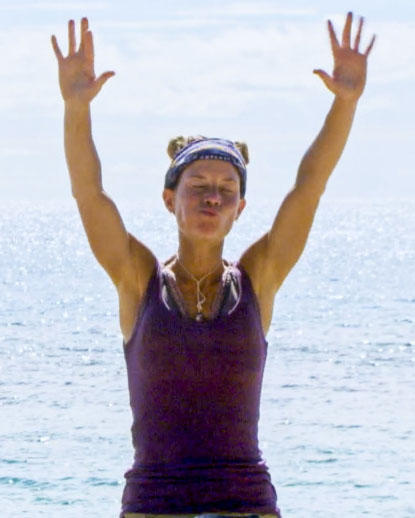 "Angela Perkins  celebrates at a ""Survivor"" immunity challenge April 25."