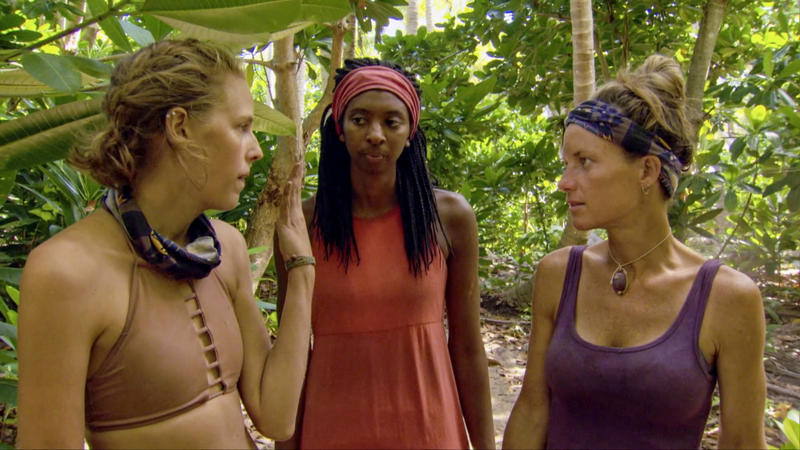 Angela Perkins (right) talks strategy with Laurel Johnson (center) and Kellyn Bechtold (left).