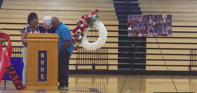 At Saturday's event at North Hardin High School, speakers read the names of the 27 people who died in the crash.