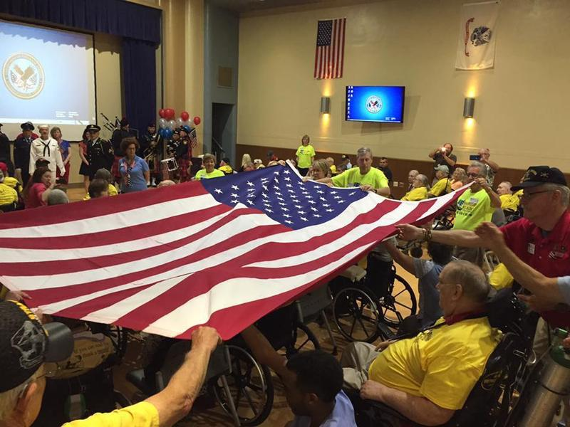 Veterans lift a flag at the Inaugural Flightless Honor Flight by Honor Flight Tri-State at Cincinnati VA Medical Center June 10, 2017.