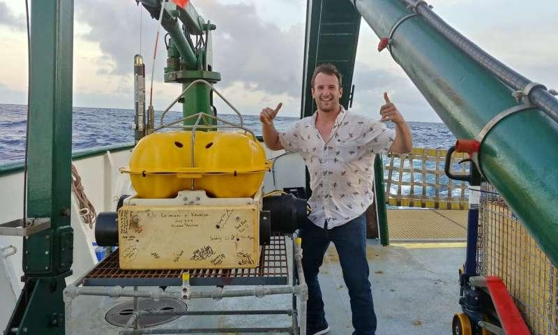 Rice University researcher David Blank stands with the last of 12 seismometers placed off the southeastern shore of the Big Island.