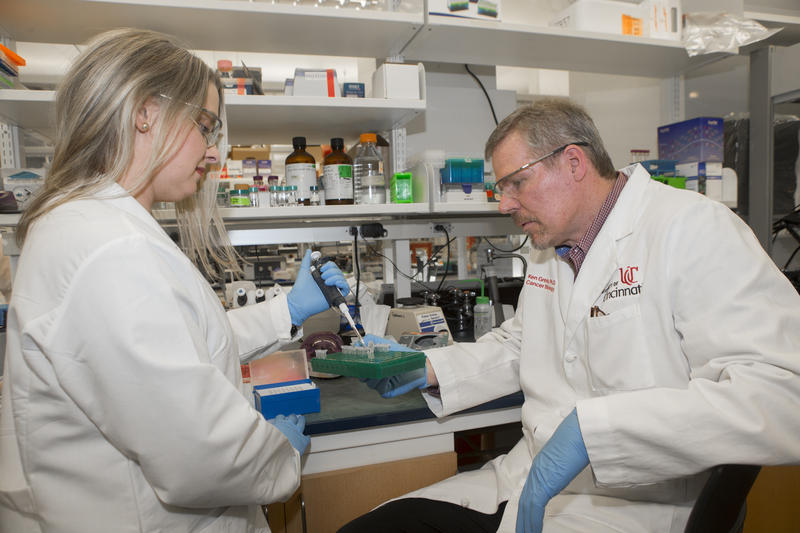 University of Cincinnati professor Ken Greis (right) says an existing drug may be effective in the fight against certain leukemias.