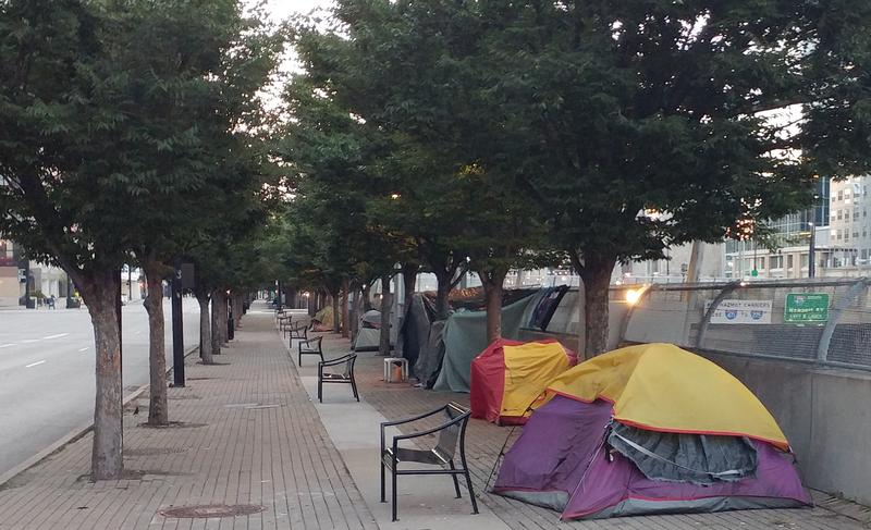 Several tents housing the homeless line Third Street in Downtown Cincinnati.