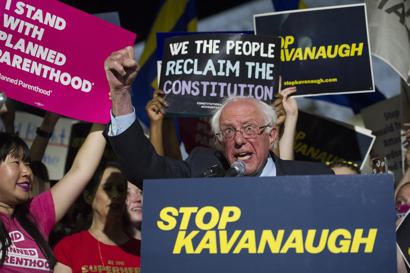 Sen. Bernie Sanders, I-Vt., speaks with protesters in front of the Supreme Court in Washington, Monday, July 9, 2018, after President Donald Trump announced Judge Brett Kavanaugh as his Supreme Court nominee.