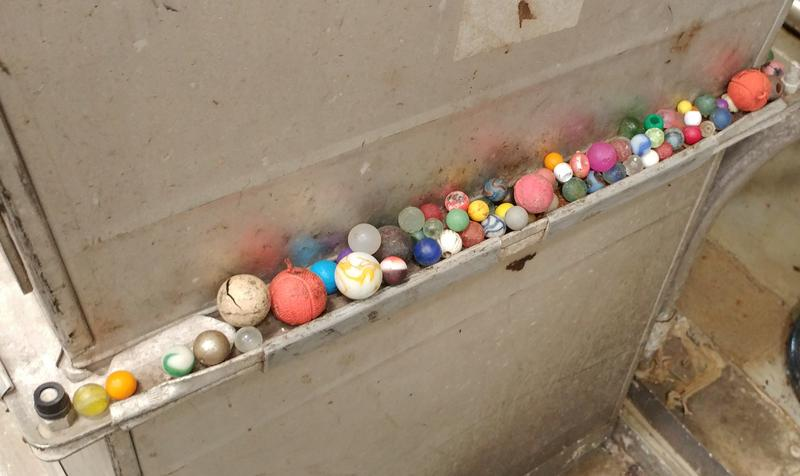 A collection of balls MSD workers plucked from the conveyor belt.