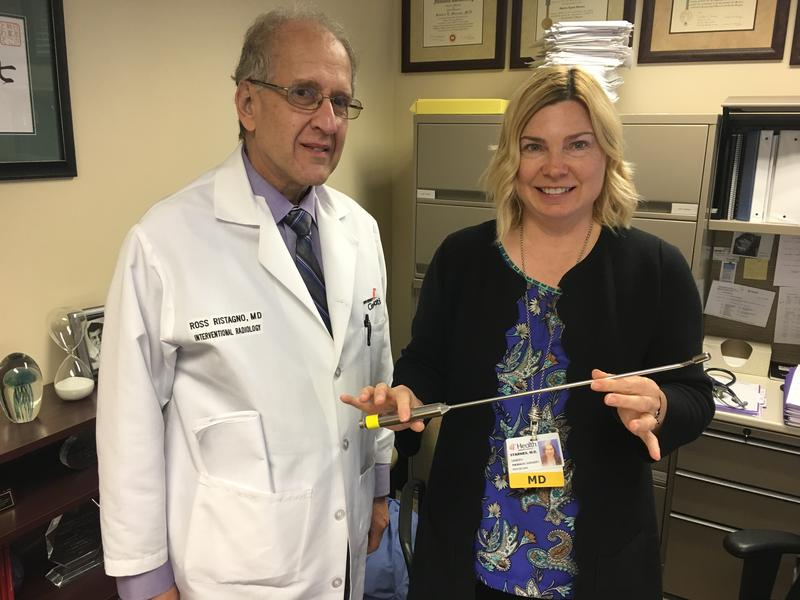 Dr. Ross Ristagno and Dr. Sandra Starnes hold the Daniel probe, which can locate lesions in a matter of seconds.