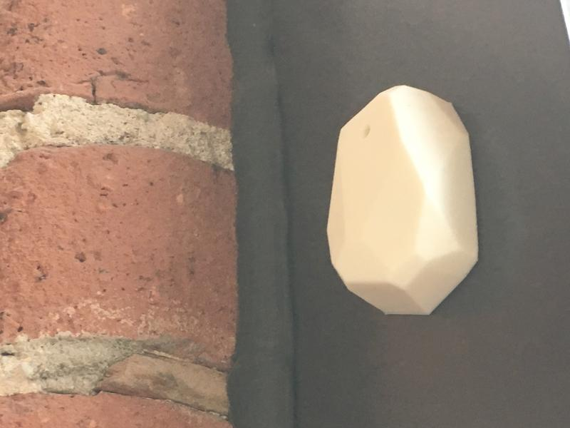 This Bluetooth beacon, displayed in Marquett Burton's office, is an example of what colleges and universities would put on their classroom walls. It can be set to a range of one foot to 150 meters.