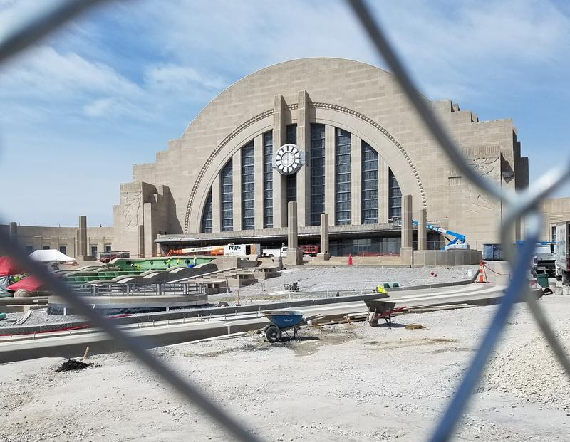 Construction crews work on reinstalling the fountain in front of Cincinnati's Union Terminal on Aug. 24, 2018.