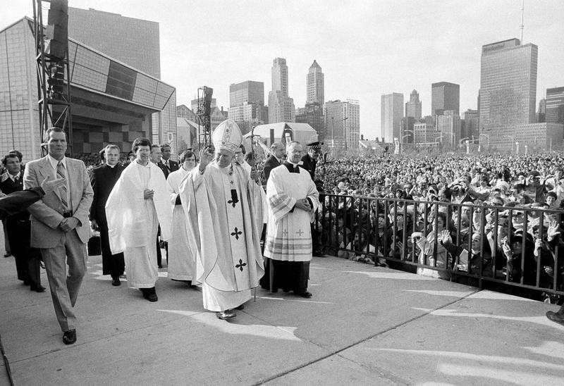 Pope John Paul II acknowledges the crowd gathered in Chicago's Grant Park before celebrating an outdoor Mass on Oct. 5, 1979.