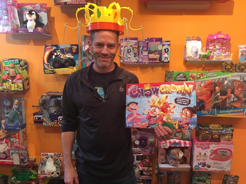 Bang Zoom Design Co-founder Mike Hoeting sports one of the holiday season's popular games - Chow Crown - in his Cincinnati showroom.