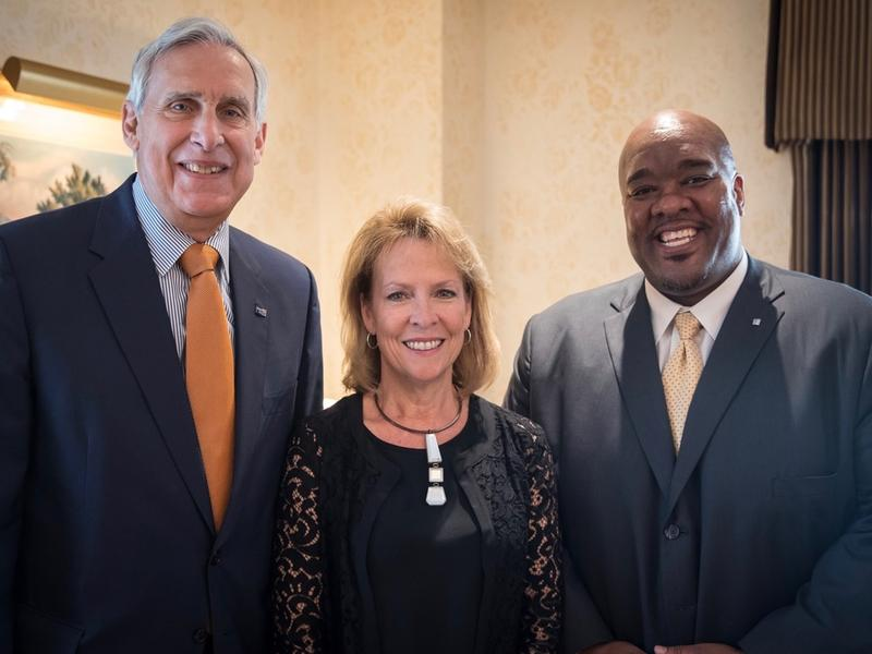 The United Way of Cincinnati is now without Board Chair Julia Poston, center, and CEO Michael Johnson, right.