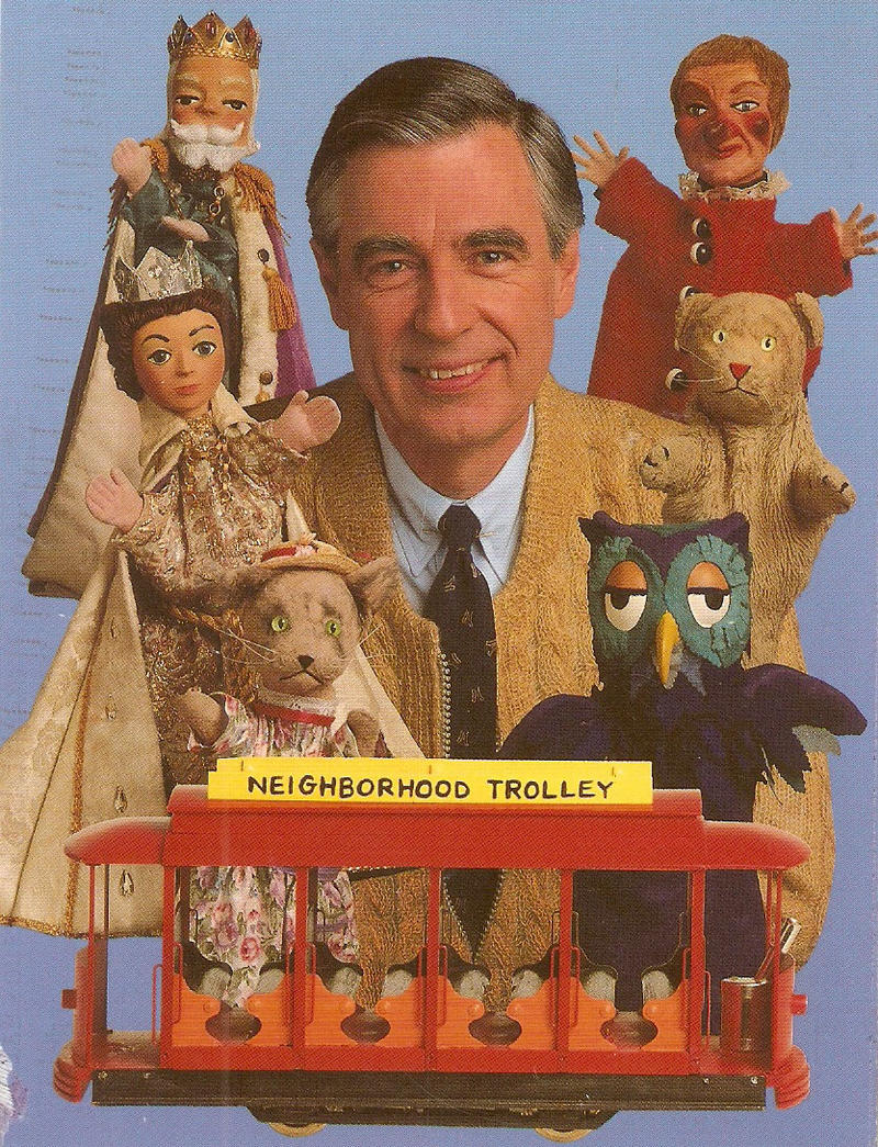 """Fred Rogers with his puppets and trolly from """"Mister Rogers' Neighborhood."""""""