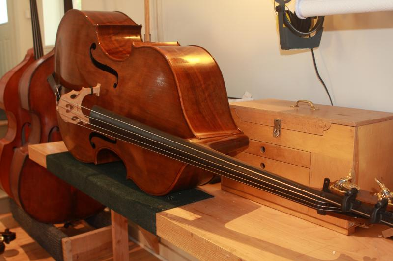 Luthier Nick Lloyd says to make a bass it takes 250 hours and $1200 of materials.