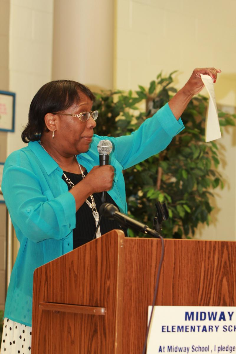 CPS Treasurer Diana Whitt discusses the 2013-2014 budget at last night's meeting.